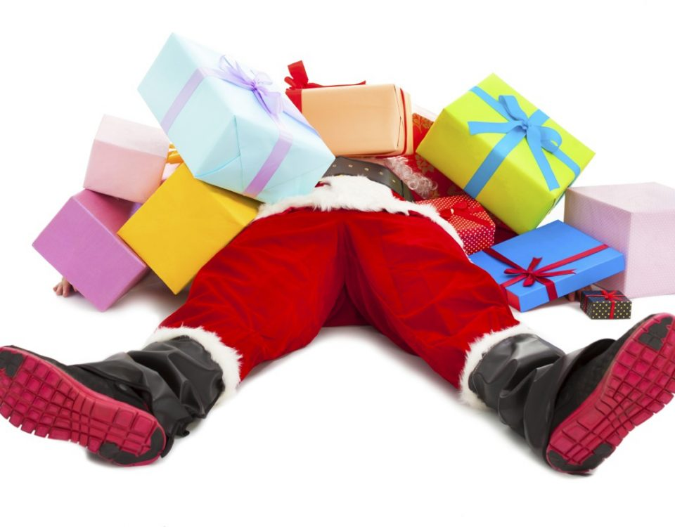 santa claus buried under gifts